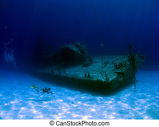 Videographer filming a sunken Shipwreck - Videographer...