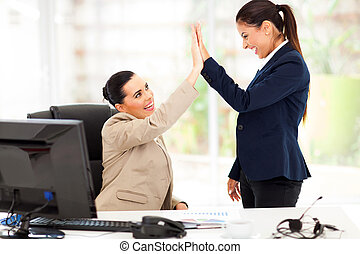 young business women doing high five - happy young business...