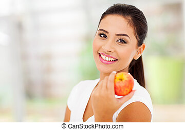 portrait of pretty woman with an apple close up