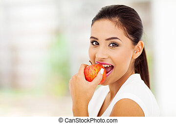 woman eating an apple - beautiful young woman eating an...