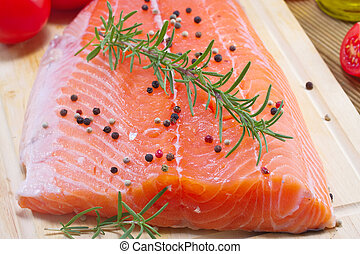 Fresh salmon fillet with herbs and vegetables
