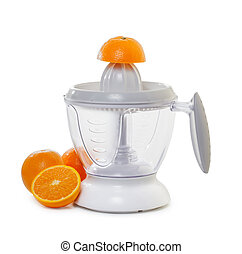 juice extractor with  ripe oranges