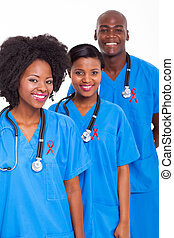 african medical workers with red ribbon
