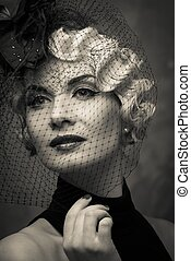 Monochrome picture of elegant blond retro woman wearing...