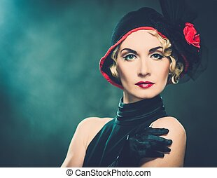 Elegant blond retro woman wearing little hat with red flower...