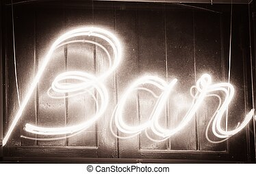 Glowing quot; Bar quot; sign at night - Glowing Bar sign at...