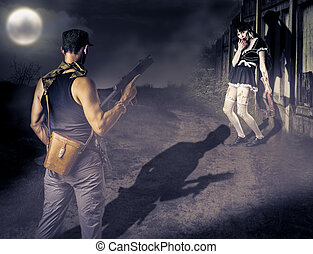 Military man and female zombie - Military man with a gun...