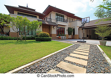 new house - A new house with a garden in a rural area under...