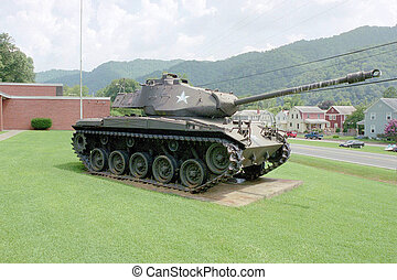 Tanks - An old tank parked in front of a national gaurd...