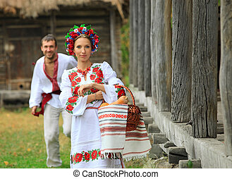 Young couple in Ukrainian style clothes outdoors
