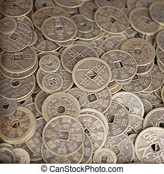 Antique bronze Chinese coins close-up background with...