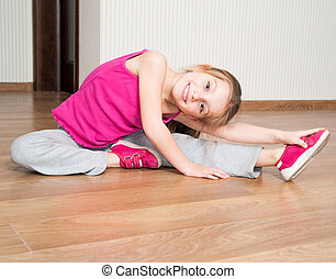 little girl engaged in fitness - smiling little girl in pink...