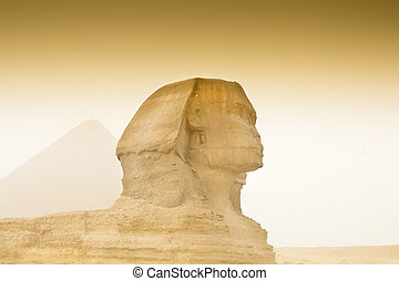 Cheops pyramid and sphinx in Egypt in sandstorm