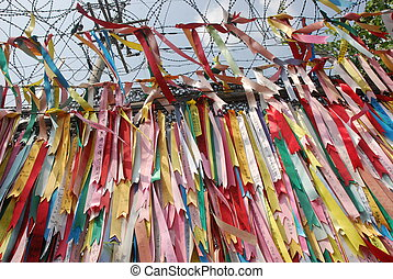 Millions of prayer ribbons tied to the fence wishing peace...