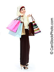muslim woman shopping - full body portrait of young muslim...