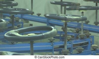Steering wheels on a conveyor - Freshly painted steering...