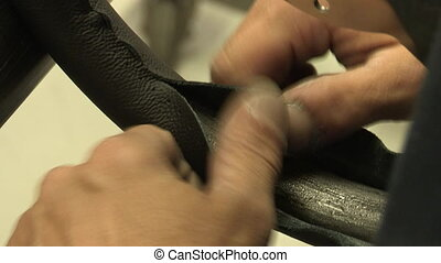 Assembly of leather steering wheel - Hands of a factory...