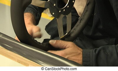 Assembly of leather steering wheel - Factory employee...