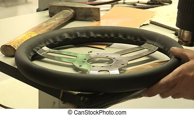 Assembly of leather steering wheel - Factory worker drying...