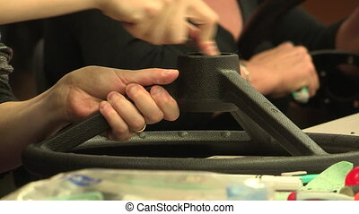 Assembly of steering wheel - Factory employees work on...