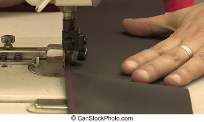 Sewing leather - Sewing a bright pink border on a strip of...