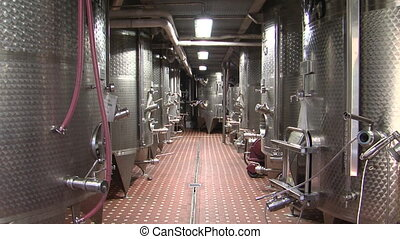 Wine distilling vats at a winery - Stainless steel wine...