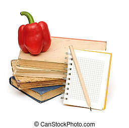 pencil on notebook near pile of books for your recipes, menu...