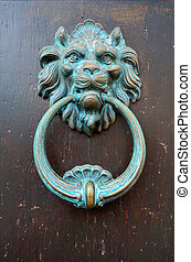 Old door knocker in the shape of a lion's head