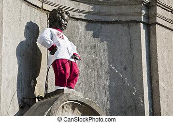 Manneken Pis - The dressed Manneken Pis in Brussels in sunny...
