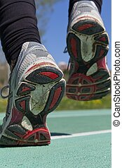 Athlete running on a track - Close up of athletic sneakers...