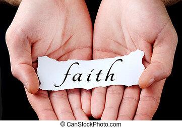 Man holding faith word
