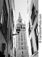 Seville - Old street and Giralda bell tower, Seville