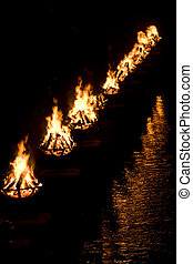 Water Fire - A shot of the burning bowls of fire set on the...