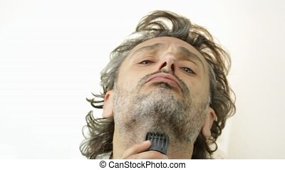 electric razor - man with electric shaver over white