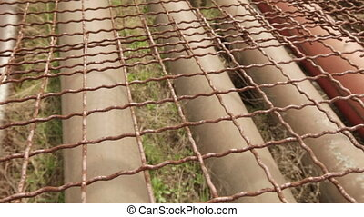 Protect pipes from the transmission line - Metal mesh to...