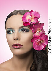 pretty brunette with fake flowers - beauty portrait of...