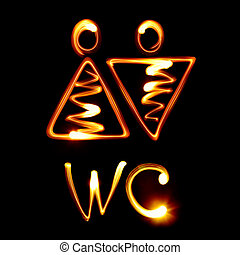 WC sign pictured by light
