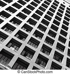 Building with balconies. Black and white image