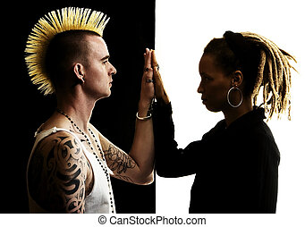 Man with Mohawk and Woman with Dreadlocks - Caucasian Man...