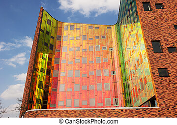 Office building with colorful reflexions in windows