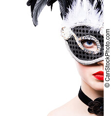 Beautiful young woman in black carnival mask on white...