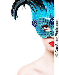 Beautiful young woman in blue carnival mask on white...