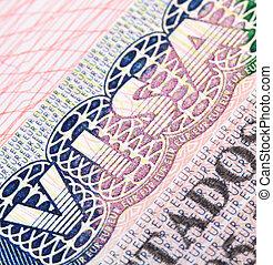 Schengen visa - Macro shot of Schengen visa in passport
