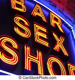 Sex shop - Bar and sex shop neon sign close-up