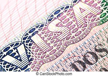 Visa - Macro shot of Schengen visa in passport