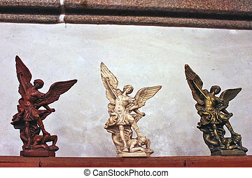 Three statuettes In the abbey church  of Mont Saint Michel. Normandy, France