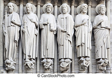 Saints on fasade of The Notre Dame de Paris France