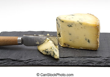 Cheese board - Stilton cheese on slate board with knife and...