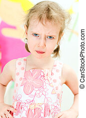 Portrait of little girl looking in to the camera with anger