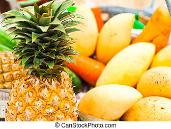 Selling tropical fruits and vegetables at market